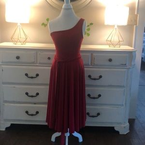 Deep red one shoulder dress.